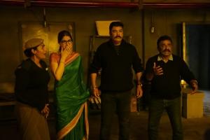Sakshi Chaudhary, Sundar C in Iruttu Movie HD Images