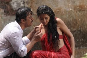 Arjun Sarja, Surveen Chawla in Itlu Prematho Movie Hot Stills