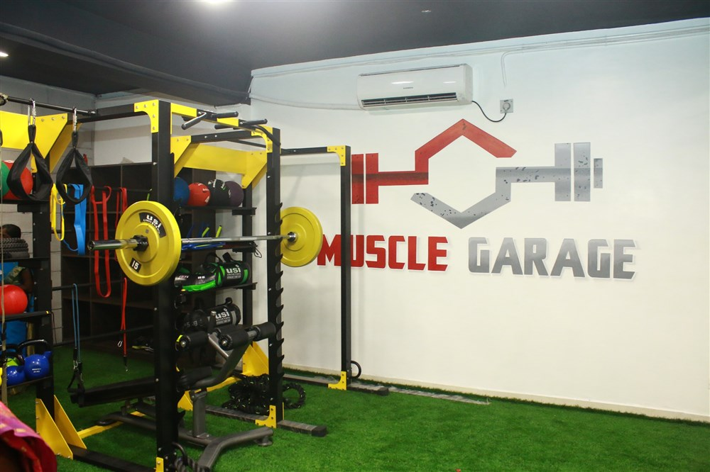 Picture  actor jiiva inaugurated muscle garage