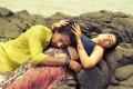 Satya, Charmme in Jyothi Lakshmi Movie Stills