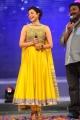 Kajal in Beautiful Yellow Designer Dress at Naayak Audio Launch