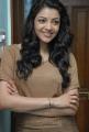 Actress Kajal Photoshoot Pics in Light Brown T Shirt & Blue Jeans