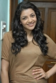 Actress Kajal Agarwal Photoshoot Pics in Light Brown T Shirt & Blue Jeans