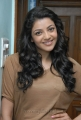 Actress Kajal Agarwal in Light Brown T Shirt Photoshoot Pics