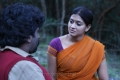 Arjuna, Varsha Ashwathi in Kangaroo Tamil Movie Stills