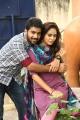 Sachin Mani, Nandita Swetha in Kathiruppor Pattiyal Movie Stills