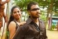 Actress Anvitha, Ashok in Koyambedu Perundhu Nilayam Movie Stills