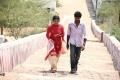 Swathi, Lagubaran in Kurra Karuki Thondarekkuva Movie Stills