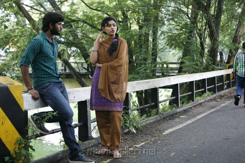 Kathir, Oviya in Madha Yaanai Koottam Telugu Movie Stills