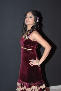 Madhavi Latha Hot Stills in Dark Red Violet Dress