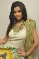 Actress Madhurima New Photos in Sleeveless White Long Dress
