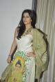 Madhurima Banerjee posing in Sleeveless White Buddha Printed Long Dress