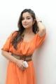 Madhurima Photos in Orange Dress at Healthy Curves, Hyderabad