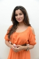 Madhurima Banerjee Photos in Orange Dress at Healthy Curves Spa Launch
