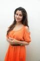 Beautiful Madhurima posing in Orange Dress