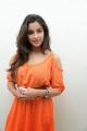 Madhurima Photos in Orange Dress at Healthy Curves Spa Launch