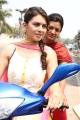 Hansika, Arya in Mande Suryudu Movie New Photos