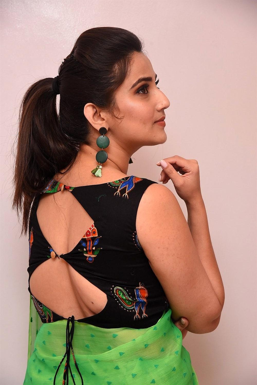 Anchor Manjusha in Black Blouse Green Saree Photos
