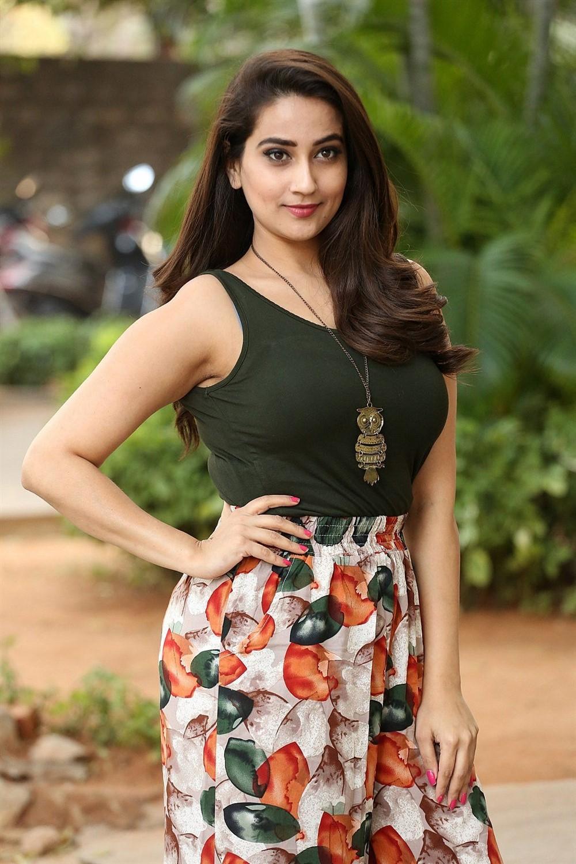 Telugu TV Anchor Manjusha Photos in Black T-Shirt & Floral Wide-Leg 3/4th Pants
