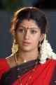 Actress Kutty Radhika in Meendum Amman Tamil Movie Stills