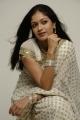 Meghna Raj in White Saree Photoshoot Stills