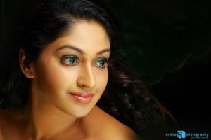 Mithra Kurian Cute Saree Photo Shoot Stills