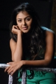 Actress Monal Gajjar Hot Stills in Green Dress