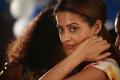 Actress Surveen Chawla in Moondru Per Moondru Kaadhal Movie Stills