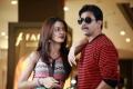 Surveen Chawla,Arjun in Moondru Per Moondru Kaadhal Movie Stills