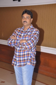 Director Satyam Bellamkonda at Mr.Manmadha Movie Audio Release Function Photos