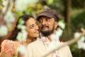 Nithya Menon, Sudeep in Mudinja Ivana Pudi Movie New Photos