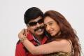Powerstar Srinivasan, Disha in Naalu Perum Romba Nallavanga Tamil Movie Stills