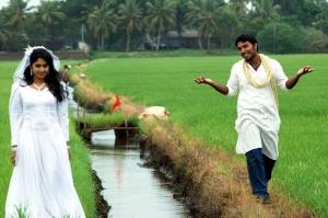 Mithra Kurian, Shivaji Dev in Nandanam Tamil Movie Stills