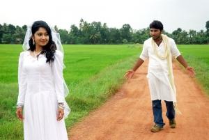 Mithra Kurian, Sivaji Dev in Nandanam Tamil Movie Stills