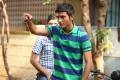 Actor Dhanush in Nava Manmadhudu Telugu Movie Stills