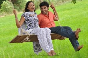 Bhooshan, Megha Nair in Nellai Santhippu Movie Stills