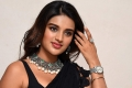 Actress Nidhi Agarwal Hot Black Saree Images @ iSmart Shankar Pre Release