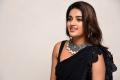 iSmart Shankar Heroine Nidhi Agarwal in Black Saree Images