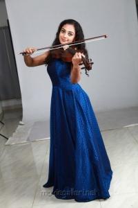Nithya Menon in Blue Dress Photos Shoot Gallery