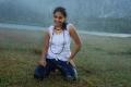 Actress Nithya Menon Wet Photos in Rain Song