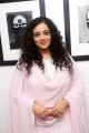 Actress Nithya Menon in Pink Churidar Photos @ Gnana Shekar Art Exhibition
