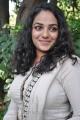 Actress Nithya Menon Photos in White Salwar Kameez
