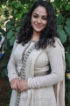 Actress Nitya Menon in White Salwar Kameez Photos