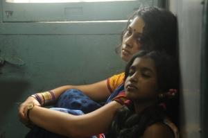 Pooja, Malavika Manikuttan in Oka Rathrilo Iddaru Ammayilu Movie Stills