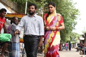 Dinesh, Manisha Yadav in Oru Kuppai Kathai Movie Stills