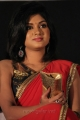 Oviya Red Saree Hot Photos @ Madha Yaanai Koottam Audio Launch