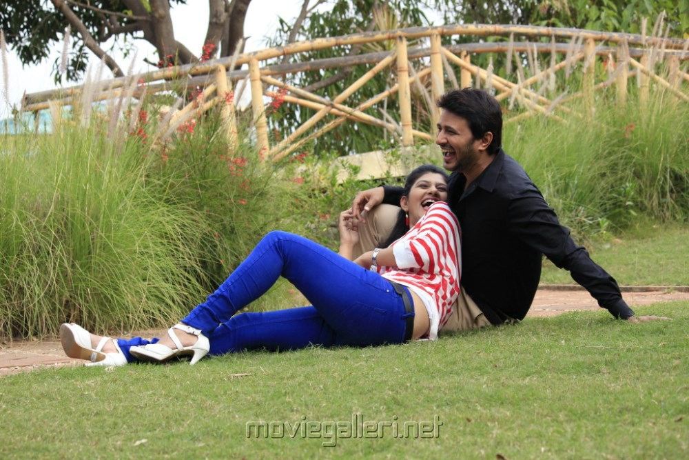 Shona Chabra, Raja in Parking Telugu Movie Stills