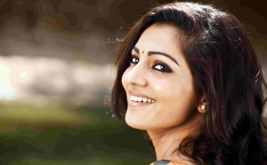 Actress Parvathi Menon Cute Smile Photos