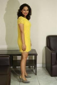 Actress Pooja Ramachandran Hot in Yellow Mini Dress Stills