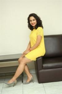 Actress Pooja Ramachandran Hot Looking Stills in Yellow Mini Dress